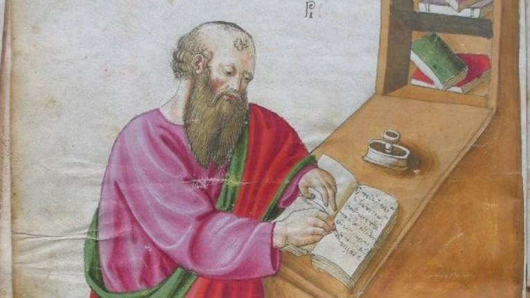 A medieval-looking drawing of a bearded white person in pink and red robs writing in a notebook leaning against a wooden desk